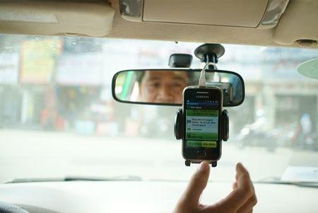 Grab, Uber taxi bi kien nghi dung hoat dong - Anh 1