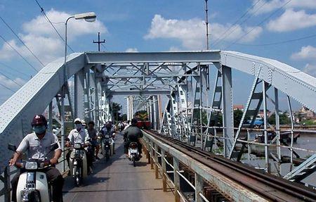 Hon 1,300 ty cai tao cau duong sat Binh Loi & nang cap 71 km luong song Sai Gon - Anh 1