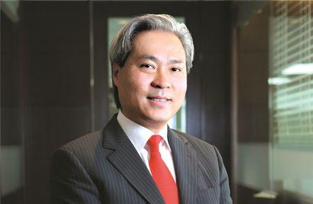 Ong Don Lam: Nen dau tu 30% cho bat dong san, 70% cho co phieu va nhom khac - Anh 1