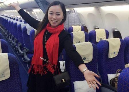 Hanh khach Trung Quoc mot minh mot may bay ve que an Tet - Anh 1
