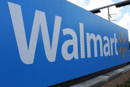Viec tang muc luong len 15 USD se tieu ton cua Wal-Mart 4.95 ty USD - Anh 1