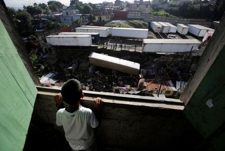 Guatemala: Mua to dai ngay gay lo dat lam 10 nguoi thiet mang - Anh 1
