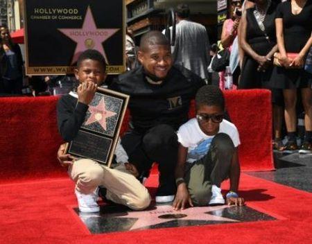 Usher 'yeu cau' fan giu sach ngoi sao cua anh tren Dai lo Hollywood - Anh 1