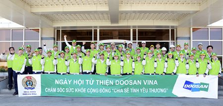 Doosan Vina la doanh nghiep thuc hien tot trach nhiem cong dong - Anh 1