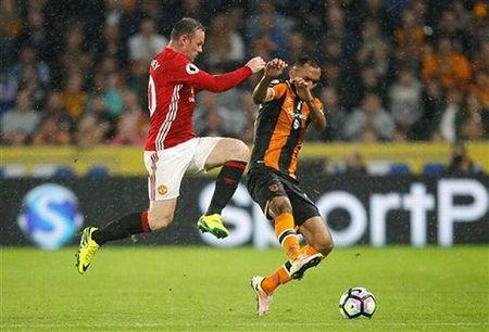 CAP NHAT tin toi 13/9: Rooney sap 'bi da' khoi Man United. Rodgers: 'Barca chang la gi neu khong co Suarez' - Anh 2