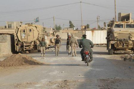 Chien su Mosul: 14 binh si Iraq tu tran cung luc - Anh 1
