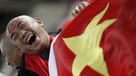 Tu thuong vu Carlos Tevez: Triet ly bong da kieu... Trung Quoc - Anh 1
