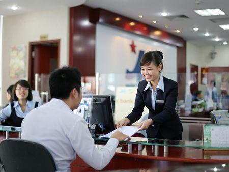 Ngan hang Quan doi dat 3.711 ty dong loi nhuan truoc thue - Anh 1