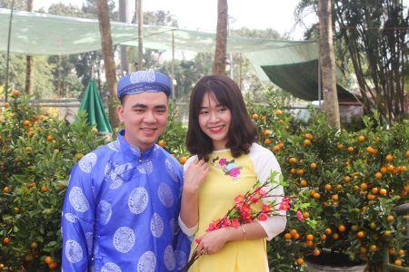 Thieu nu Hue xinh tuoi ao dai xuong pho don xuan - Anh 4