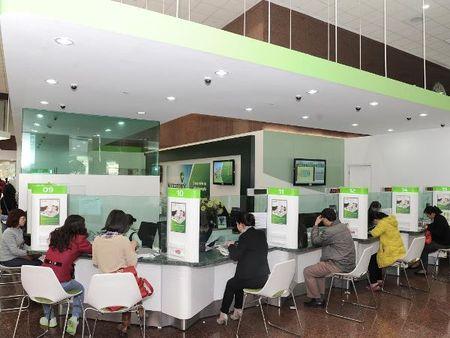 Vietcombank thay doi dau so goi ra cua Trung tam khach hang 24/7 - Anh 1