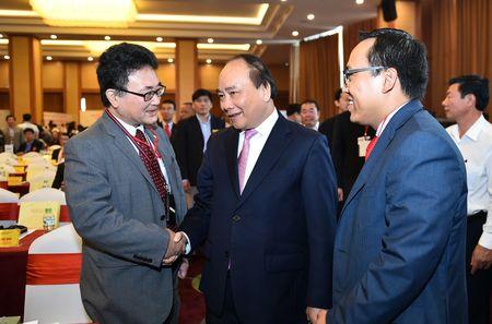 Thu tuong Nguyen Xuan Phuc du Hoi nghi xuc tien dau tu Tay Nguyen - Anh 1