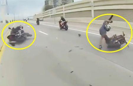 Clip: Moto va quet, 2 nguoi dan ong lan loc tren duong - Anh 1
