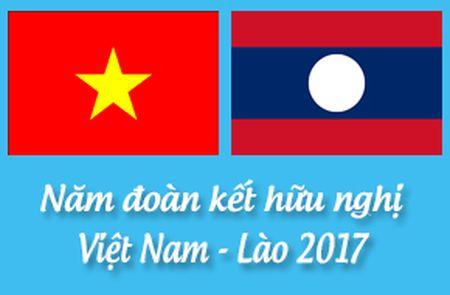 Trao doi dien mung Viet Nam-Lao nhan ky niem 55 Ngay thiet lap quan he ngoai giao - Anh 1