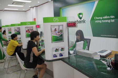 Vietcombank duoc thanh lap ngan hang con tai Lao va Van phong dai dien tai My - Anh 1