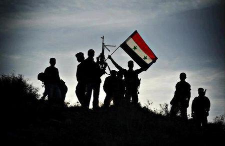 Quan doi Syria bat ngo hung that bai truoc IS o Raqqa - Anh 1