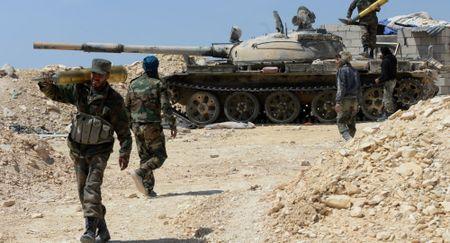 Quan doi Syria danh bai thanh tri lon nhat cua IS o Homs - Anh 1