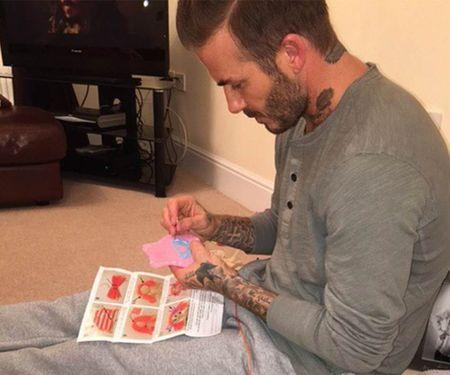 David Beckham chap nhan 'lui ve hau cung' thay vo cham soc gia dinh - Anh 17