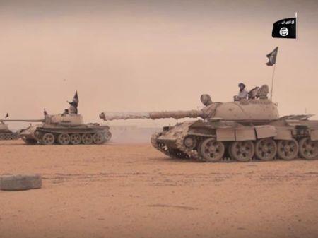 IS tan cong manh o nam Raqqa, gan 100 binh sy Syria tu tran - Anh 1