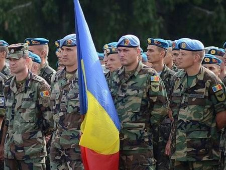 Chinh phu Moldova van dieu binh sy tham gia tap tran cua NATO - Anh 1