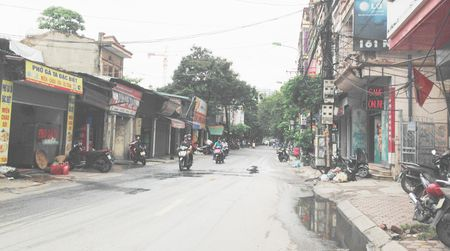 Ha Noi: Van cai tao, mo rong duong Nguyen Tuan - Anh 1