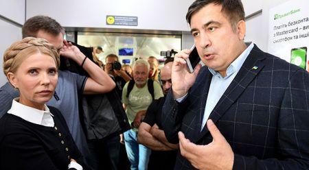Mikheil Saakashvili cung cuu Thu tuong Ukraine Yulia Tymoshenko vuot bien vao Ukraine - Anh 1