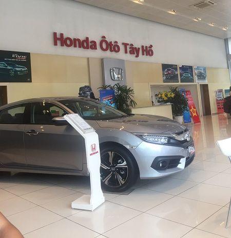 Ban oto tren giay cua Honda oto Tay Ho: Honda co the bi kien ra toa - Anh 1