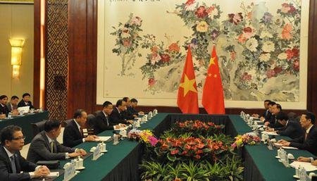 PTT thuong truc Truong Hoa Binh hoi kien PTT Trung Quoc Truong Cao Le - Anh 2
