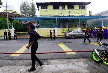 Chay lon tai truong hoc Malaysia, 25 nguoi thiet mang - Anh 3