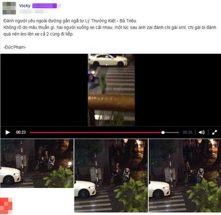 Nam thanh nien tum co ao roi tat toi tap vao mat ban gai giua duong pho Ha Noi - Anh 1