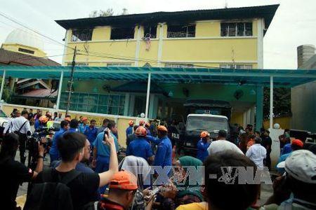 Malaysia bat 7 nghi pham gay hoa hoan truong hoc khien 23 nguoi thiet mang - Anh 1