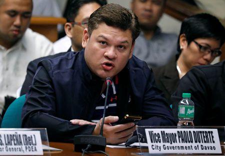 Bi mat bieu tuong hinh xam cua con trai Tong thong Philippines - Anh 1