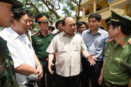 Thu tuong thi sat tan noi viec giup dan chong bao - Anh 1