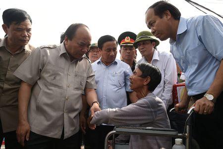 Thu tuong thi sat tan noi viec giup dan chong bao - Anh 2