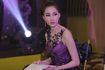 Hoa hậu Đặng Thu Thảo khoe đường cong với váy dạ hội tím
