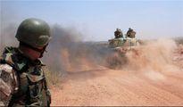 Phớt lờ liên quân Mỹ, quân đội Syria đẩy mạnh tấn công IS ở Raqqa
