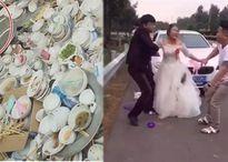 Vừa cởi váy cưới ra, cô dâu ngồi rửa hết 30 mâm bát