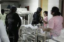 Xông vào bệnh viện xả súng để giải cứu tội phạm giết người