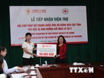 Trung Quốc ủng hộ tiền giúp người dân vùng núi Tây Bắc Việt Nam