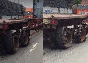 Xe container vẫn chạy trên đường dù 4 bánh nát bươm