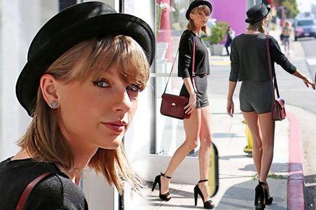 Taylor Swift khoe doi chan thon dai duoc bao hiem 40 trieu USD - Anh 1