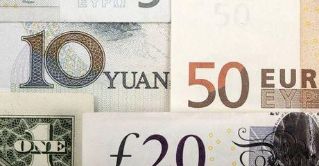 Dong USD suy yeu bat chap bao cao kinh te khoi sac - Anh 1