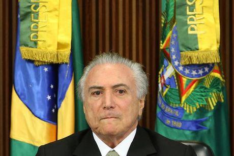 Kinh te Brazil chiu nhieu cu soc giua canh suy thoai lich su - Anh 1