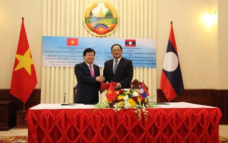 Chinh phu Viet Nam-Lao tang cuong hop tac phat trien cac du an dien - Anh 2