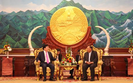 Pho Thu tuong Chinh phu Trinh Dinh Dung tiep kien lanh dao Lao - Anh 1