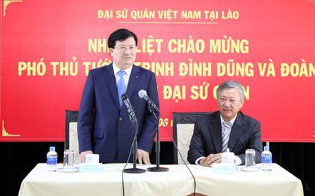 VN trao Huan chuong Doc lap hang Nhat cho Bo Cong chinh va Van tai Lao - Anh 3