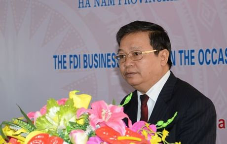 Chan dung Chu tich UBND tinh Ha Nam Nguyen Xuan Dong - Anh 1