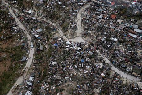 Chum anh: Haiti te liet, 339 nguoi chet vi sieu bao Matthew - Anh 4