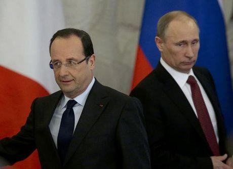 Bat chap Hollande lanh lung, Tong thong Putin van tham Phap - Anh 1