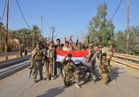 Quan doi Iraq giai phong lang mac o Anbar khoi IS - Anh 5