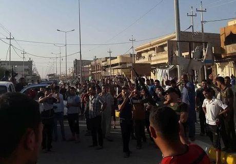 Quan doi Iraq giai phong lang mac o Anbar khoi IS - Anh 9